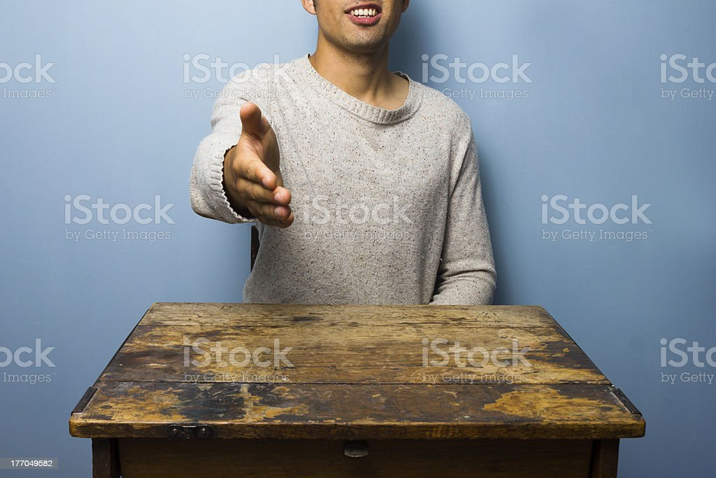 Young man offering handshake royalty-free stock photo