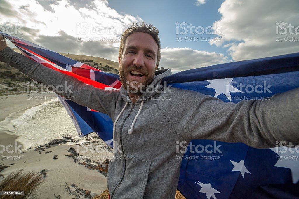 Young man on beach holding Australian's flag stock photo