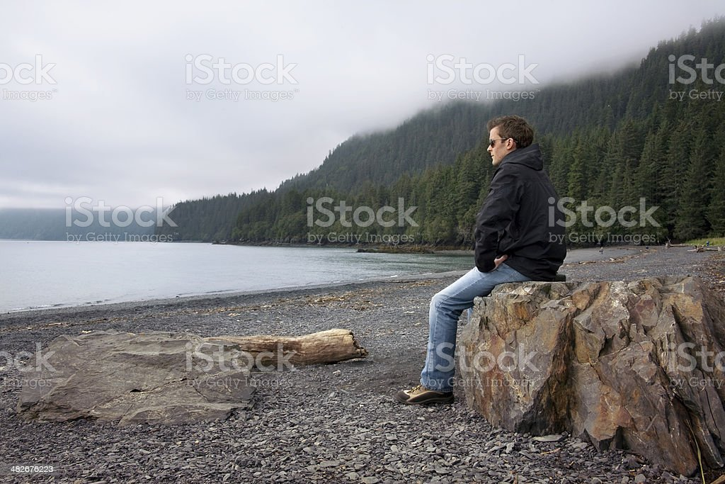 Young man on beach in Alaska royalty-free stock photo