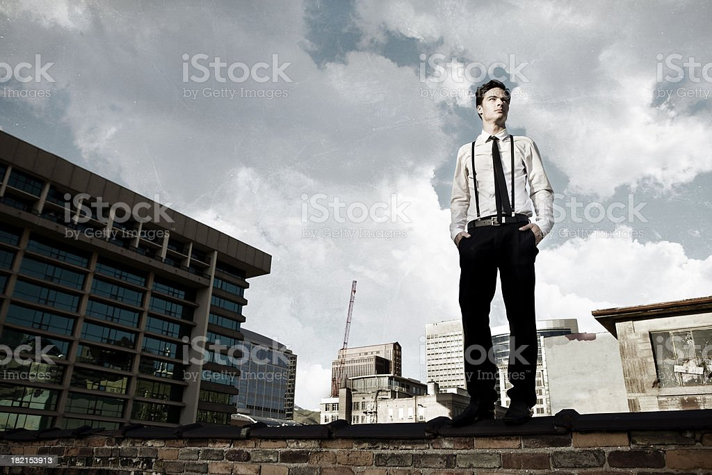 Young Man on City Rooftop stock photo