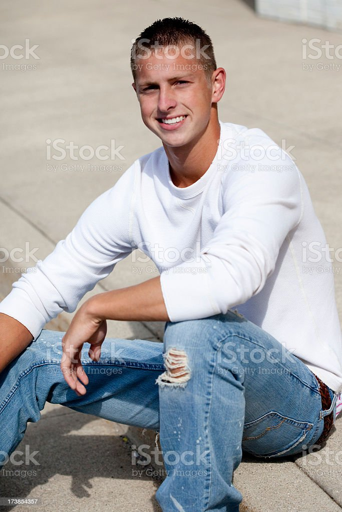 Young man on curb royalty-free stock photo