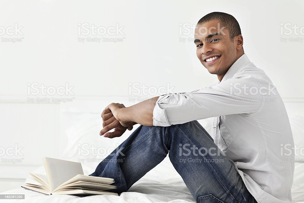Young Man on His Bed With a Book royalty-free stock photo
