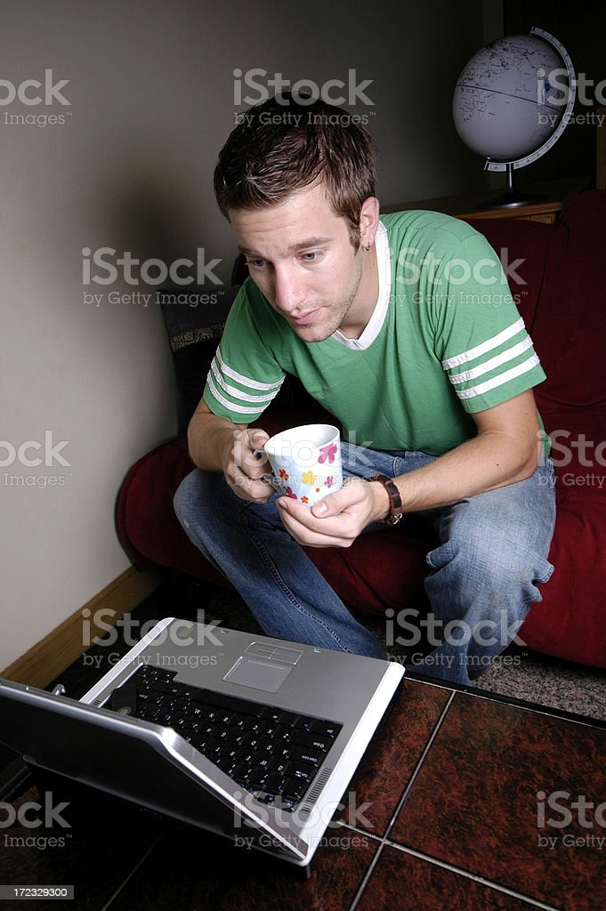 Young man on laptop royalty-free stock photo