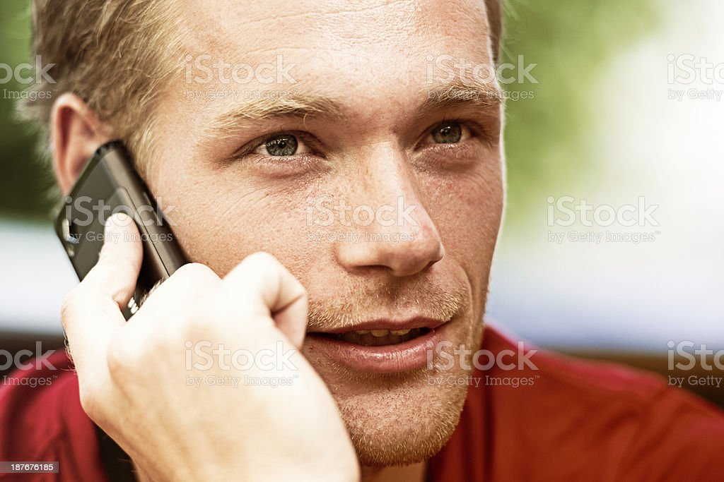 Young man on mobile phone royalty-free stock photo