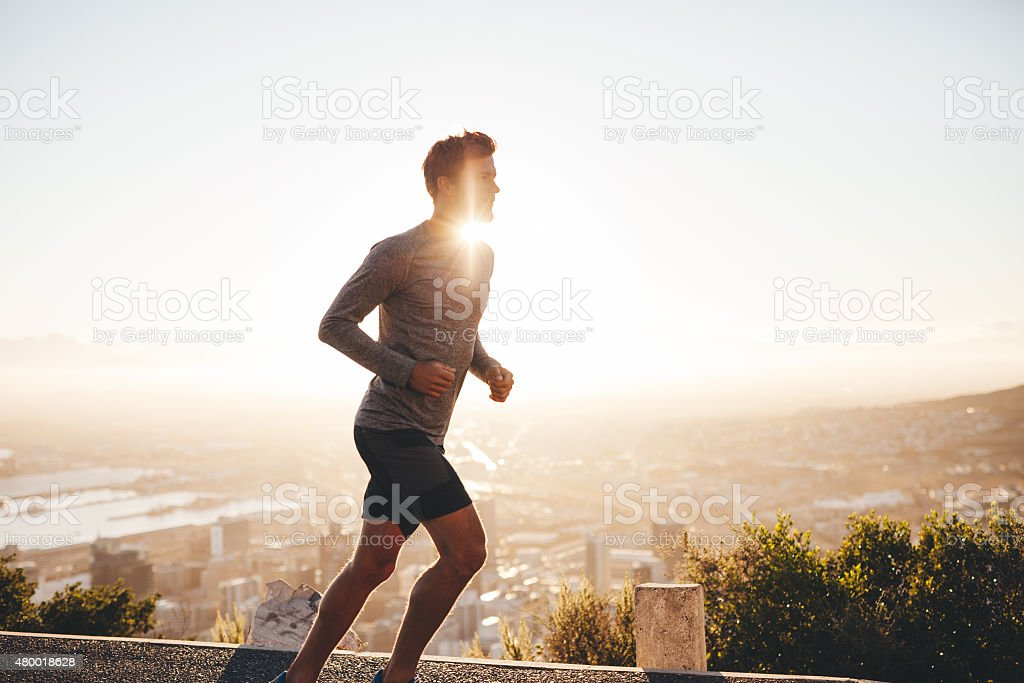 Young man on morning run stock photo