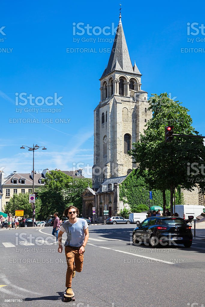 Young man on skateboard moves in motion blur in Paris royalty-free stock photo