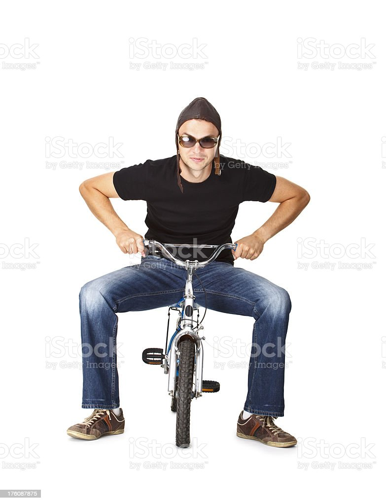young man on small bicycle royalty-free stock photo