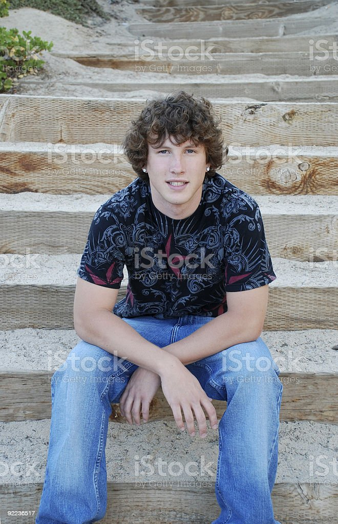 Young man on steps royalty-free stock photo