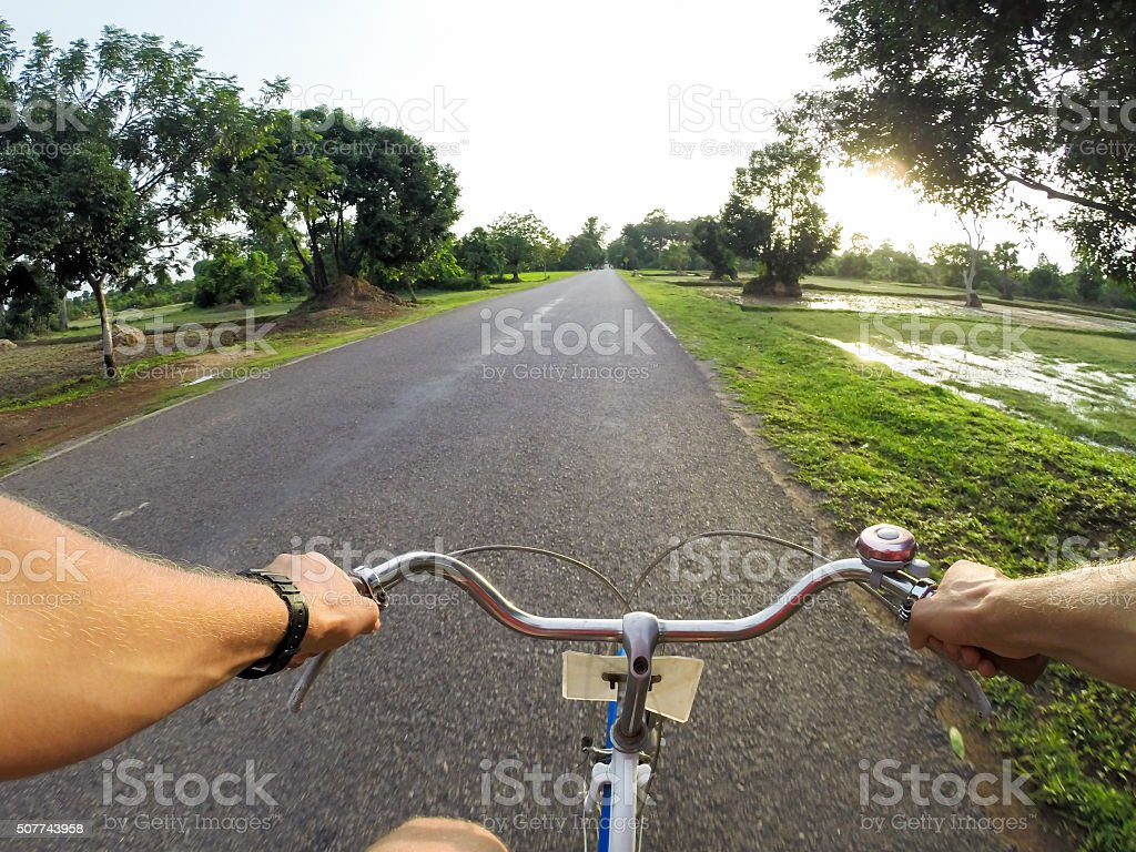 Young man on the bicycle stock photo