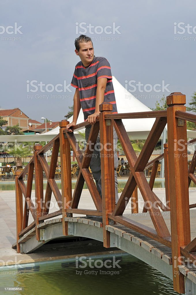 young man on the bridge royalty-free stock photo