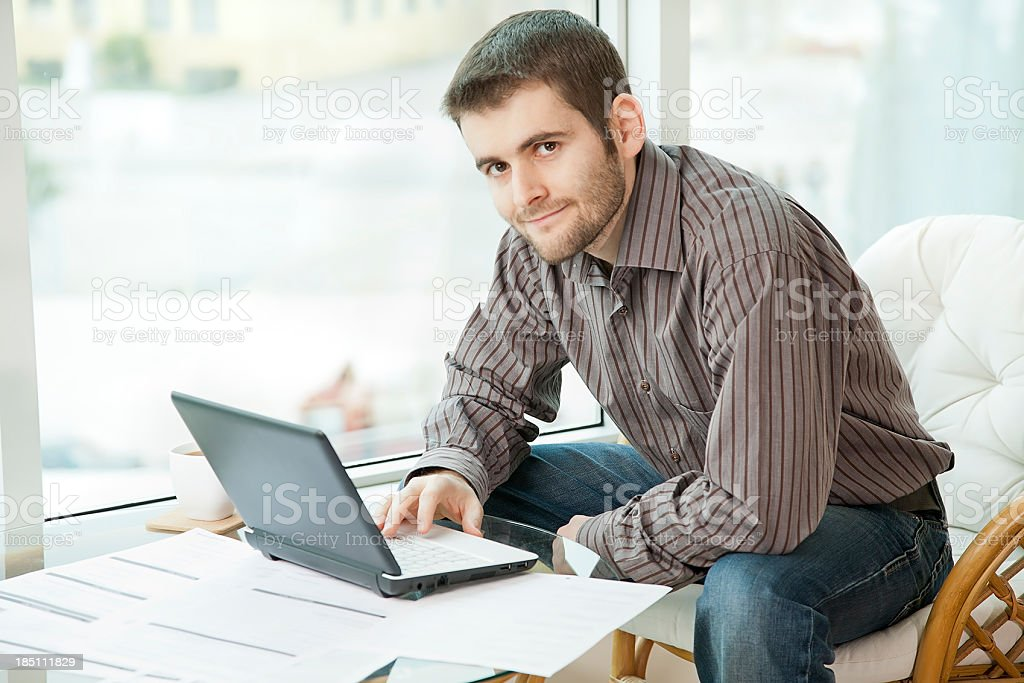 Young man on the computer,posing to camera royalty-free stock photo