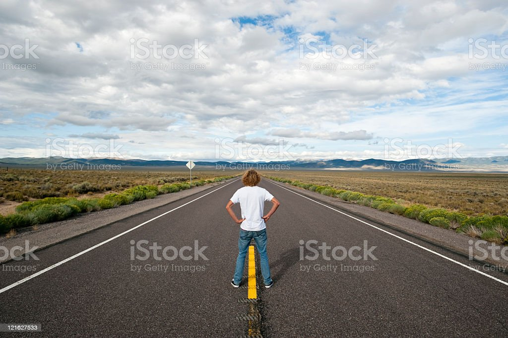 Young man on the Road stock photo