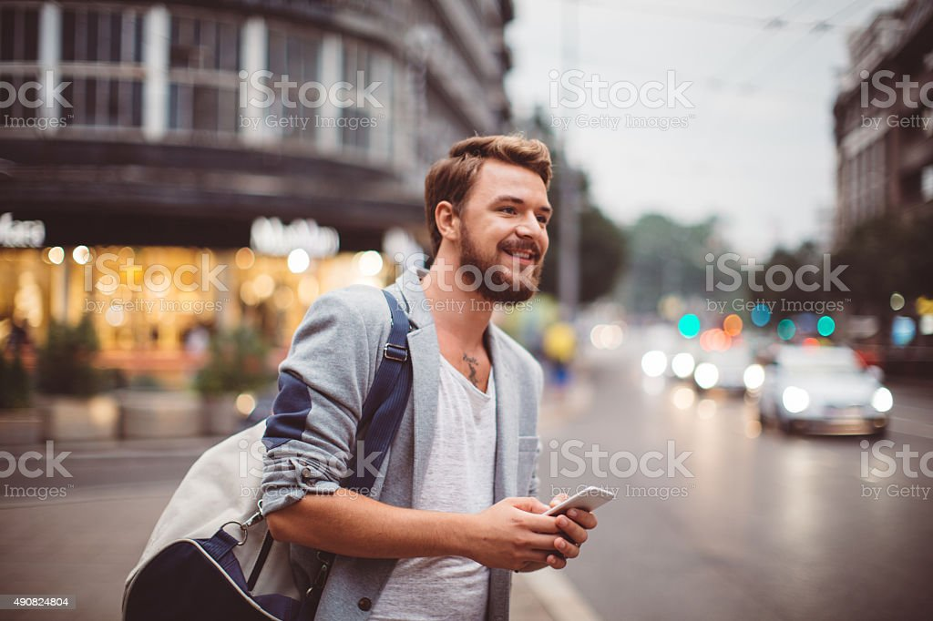 Young man on the streets of big city. stock photo