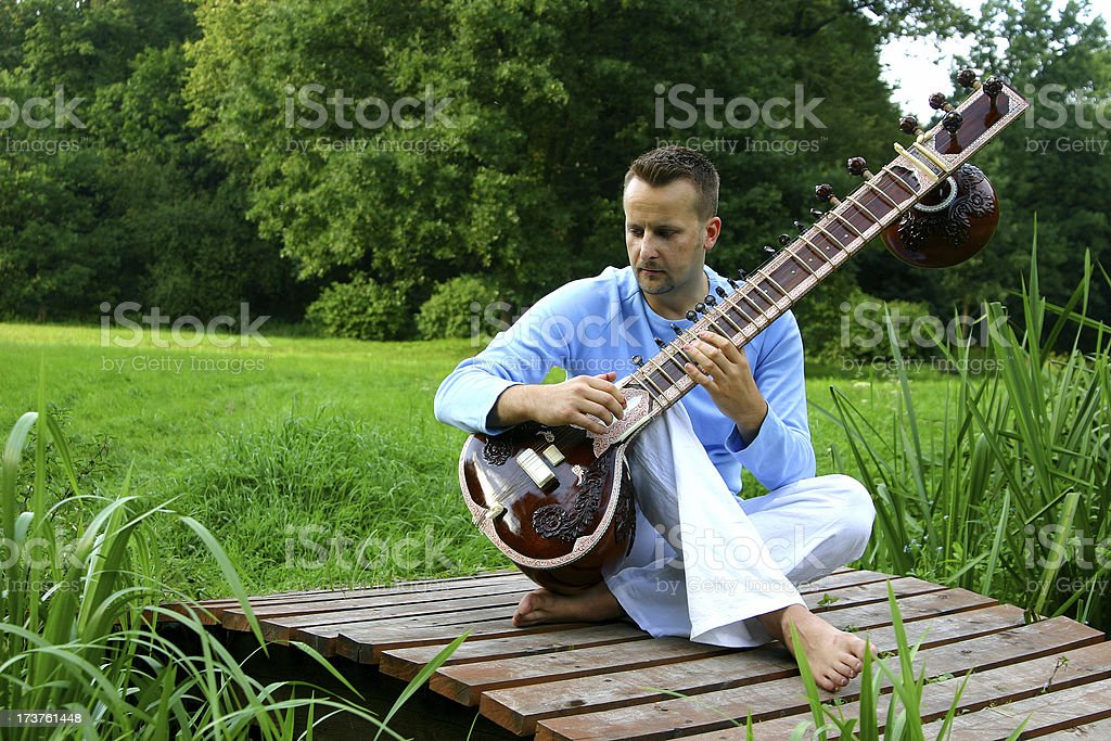 young man on the wooden sternum royalty-free stock photo