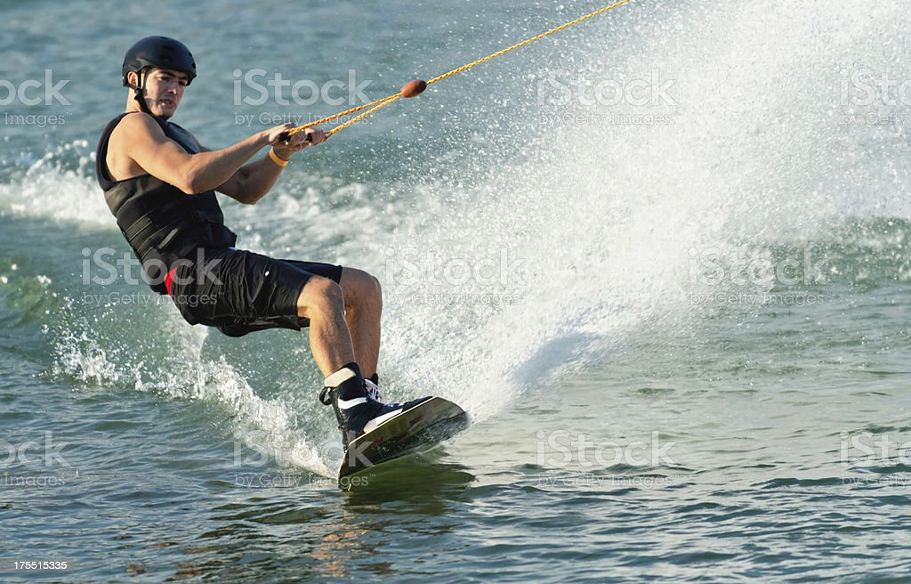 Young man on wakeboard royalty-free stock photo
