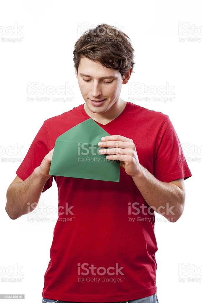 Young man opening letter royalty-free stock photo