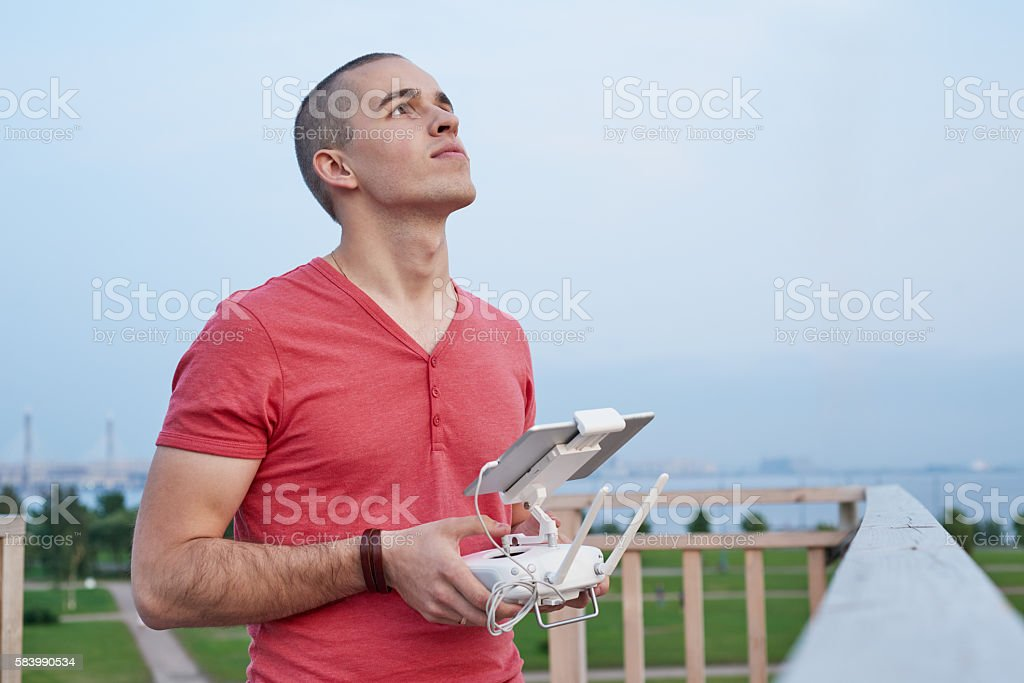 Young man operating a drone remote control console stock photo