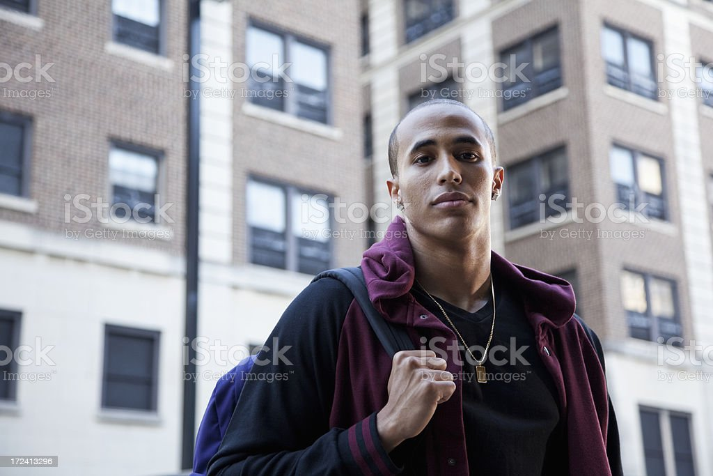 Young man outside building stock photo