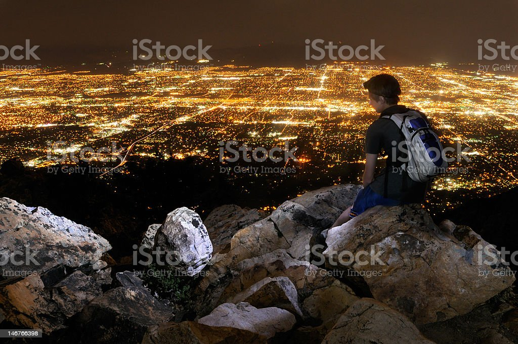 Young man overlooking Salt Lake City royalty-free stock photo