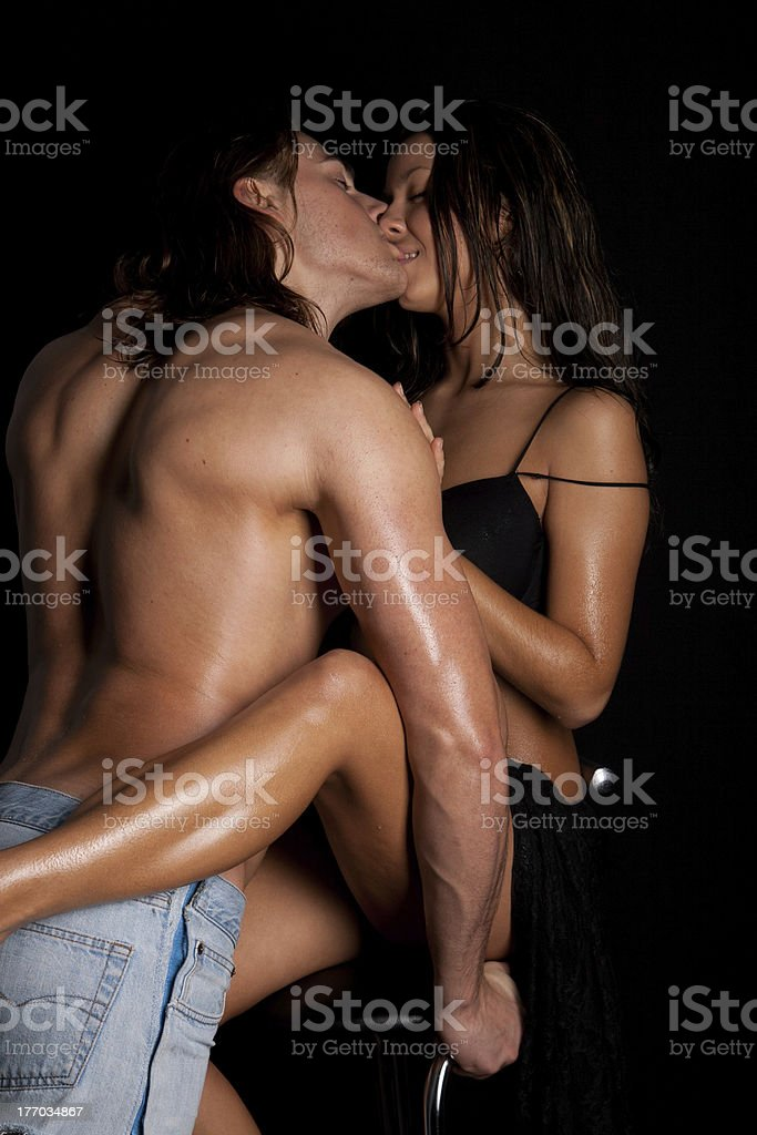 young man passionately engaged in sex with a beautiful girl royalty-free stock photo