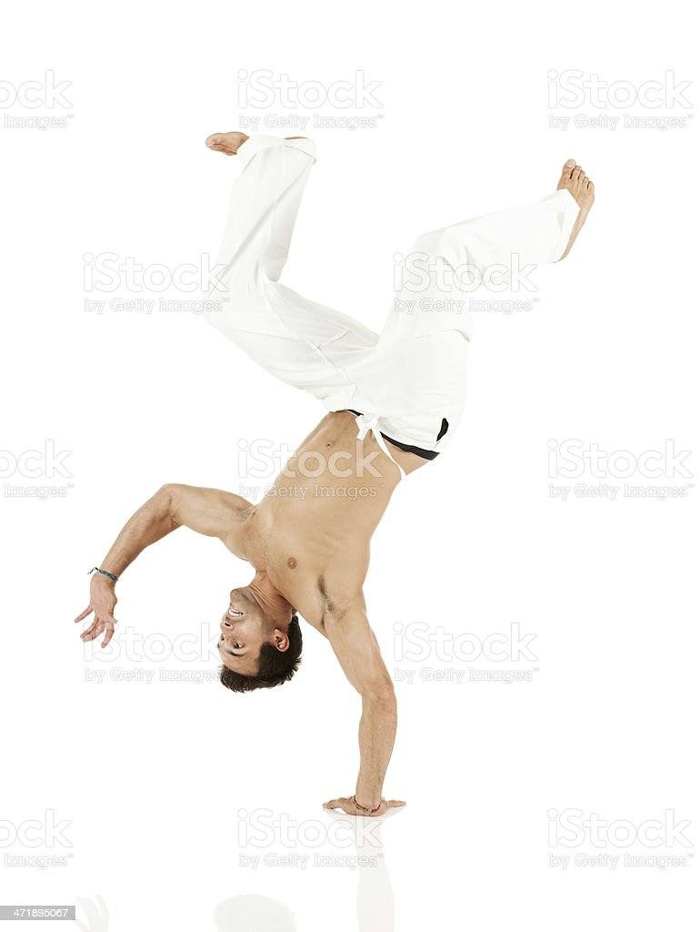 Young man performing handstand royalty-free stock photo