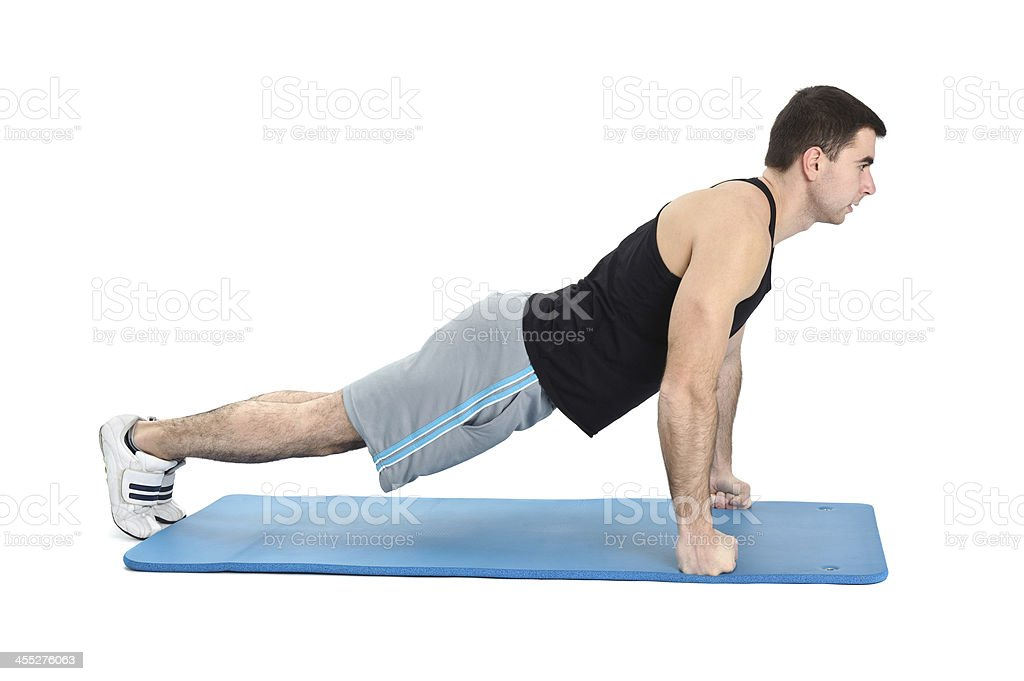 young man performing push-ups exercise on fists, phase 2 stock photo