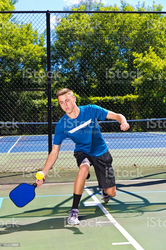 Young Man Pickleball Player Playing Pickleball in Court stock photo