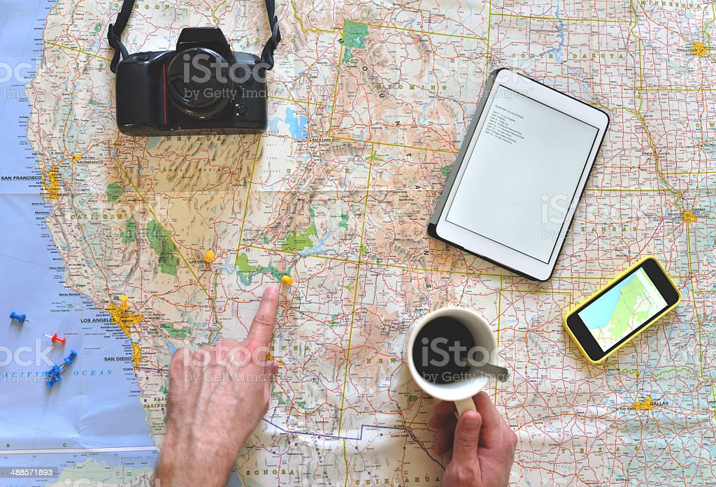 Young man planning a road trip stock photo