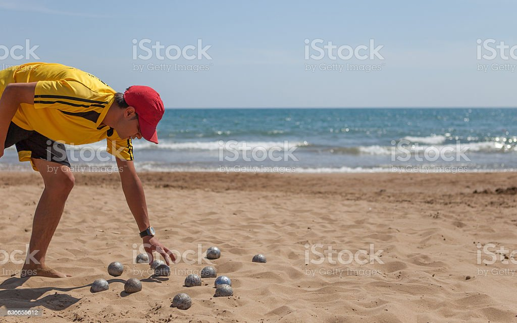 young man play Bocce Ball stock photo