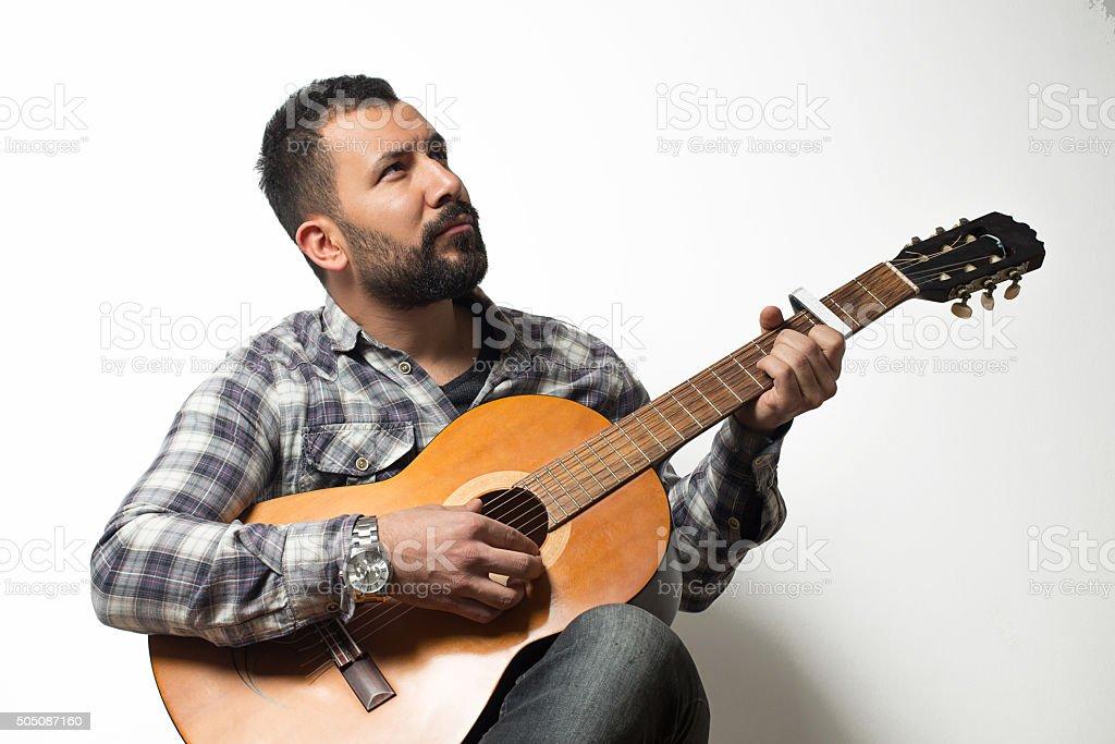 Young man play classical guitar stock photo