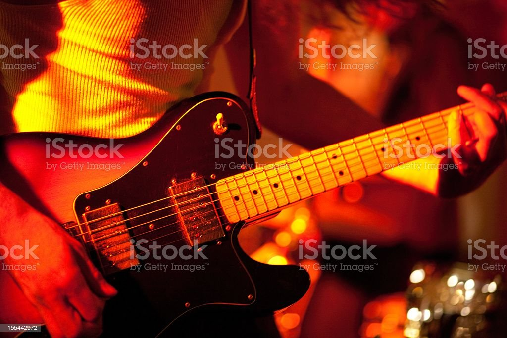 Electric guitar player on stage stock photo