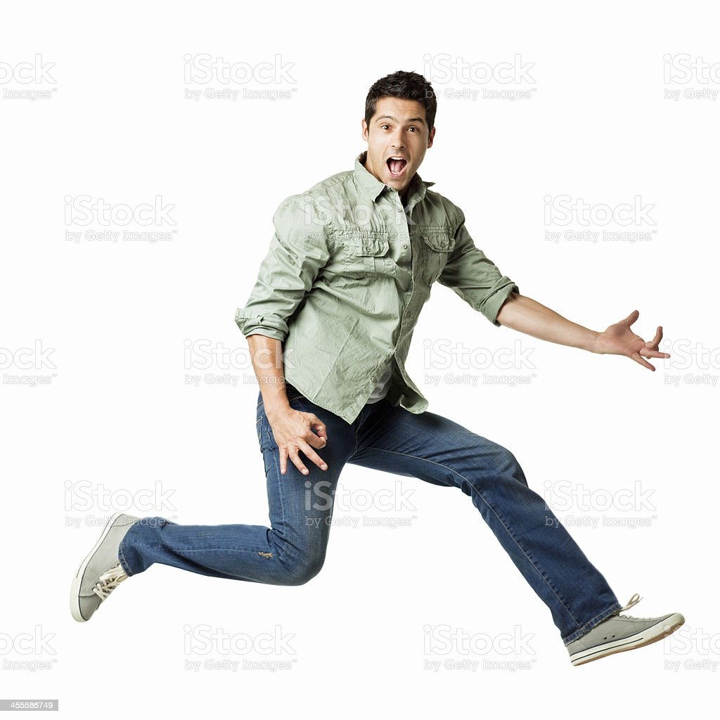 Young Man Playing an Air Guitar - Isolated stock photo