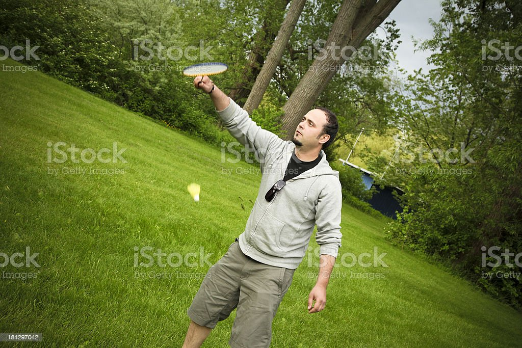Young man playing badminton royalty-free stock photo