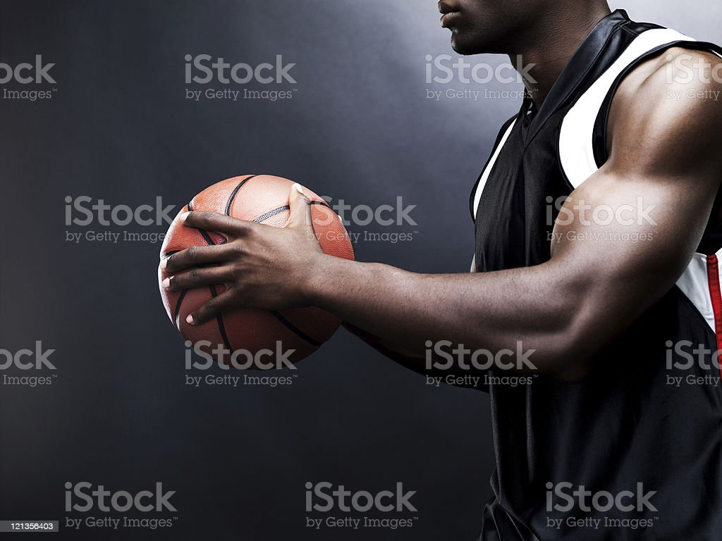 Young man playing basketball - Cropped stock photo