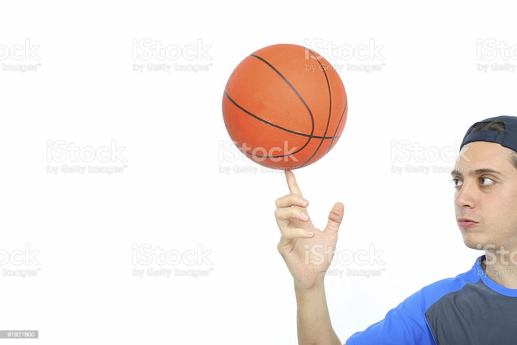 Young man playing basketball isolated stock photo