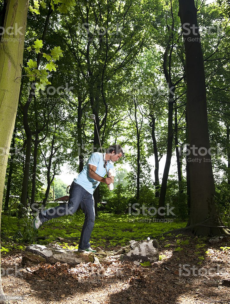 young man playing difficult golf royalty-free stock photo