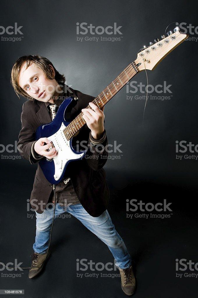 Young man playing electro guitar stock photo