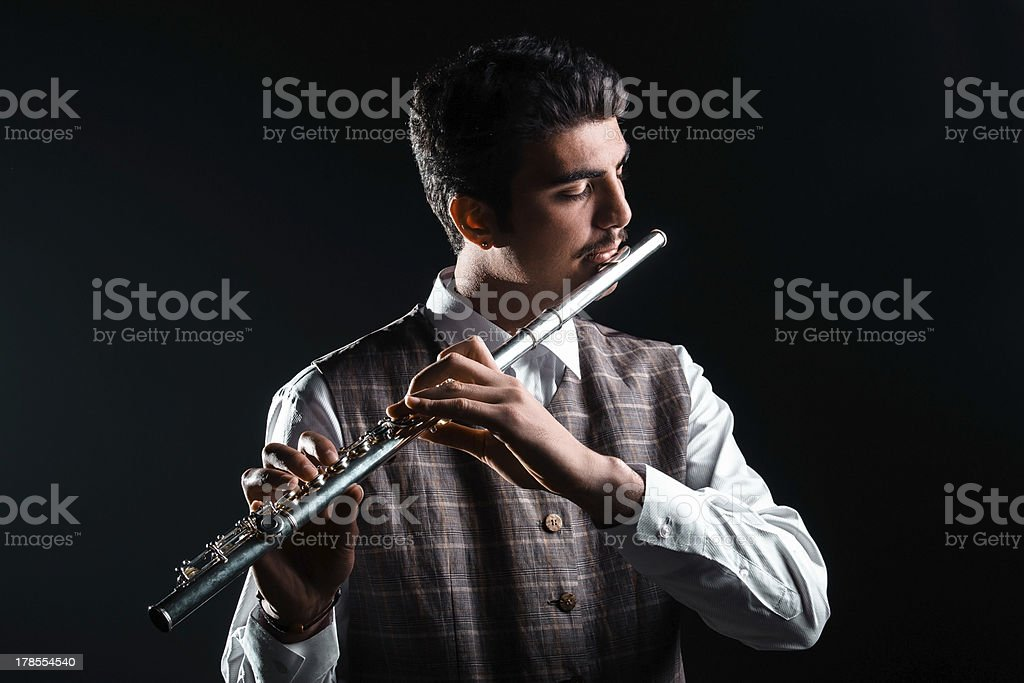 Young man playing flute royalty-free stock photo