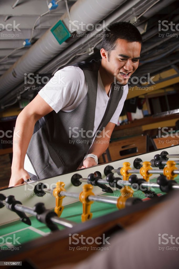 Young Man Playing Foosball royalty-free stock photo