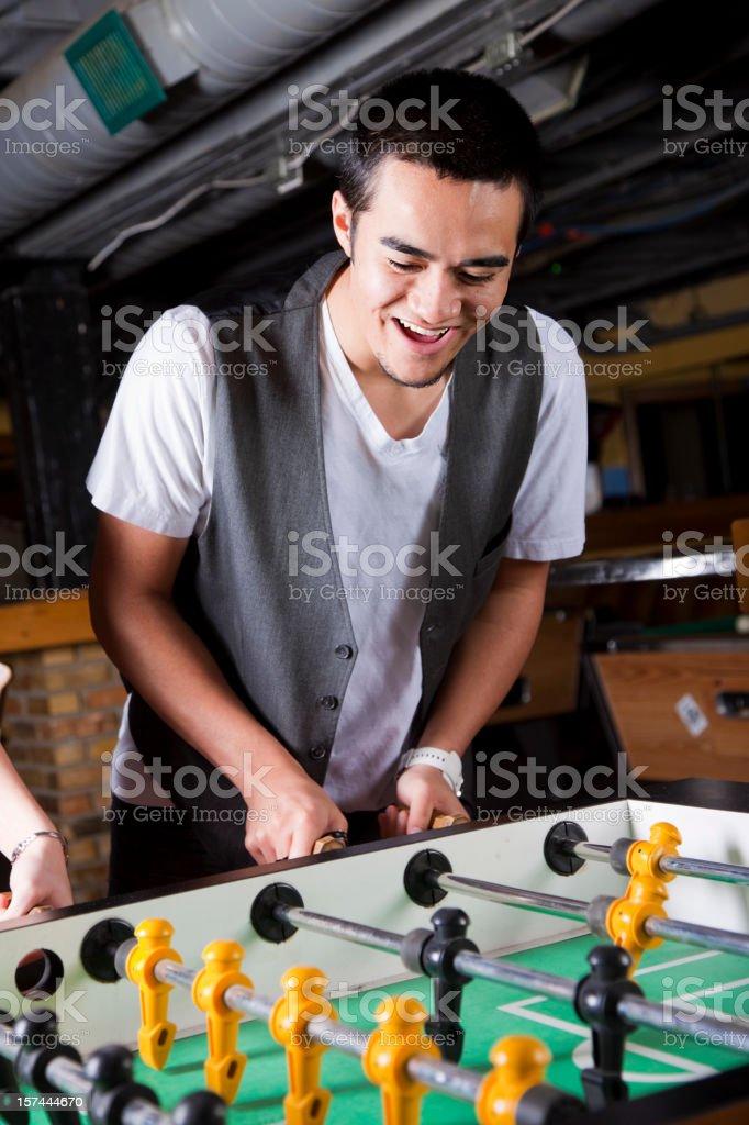 Young Man Playing Foosball royalty-free stock photo