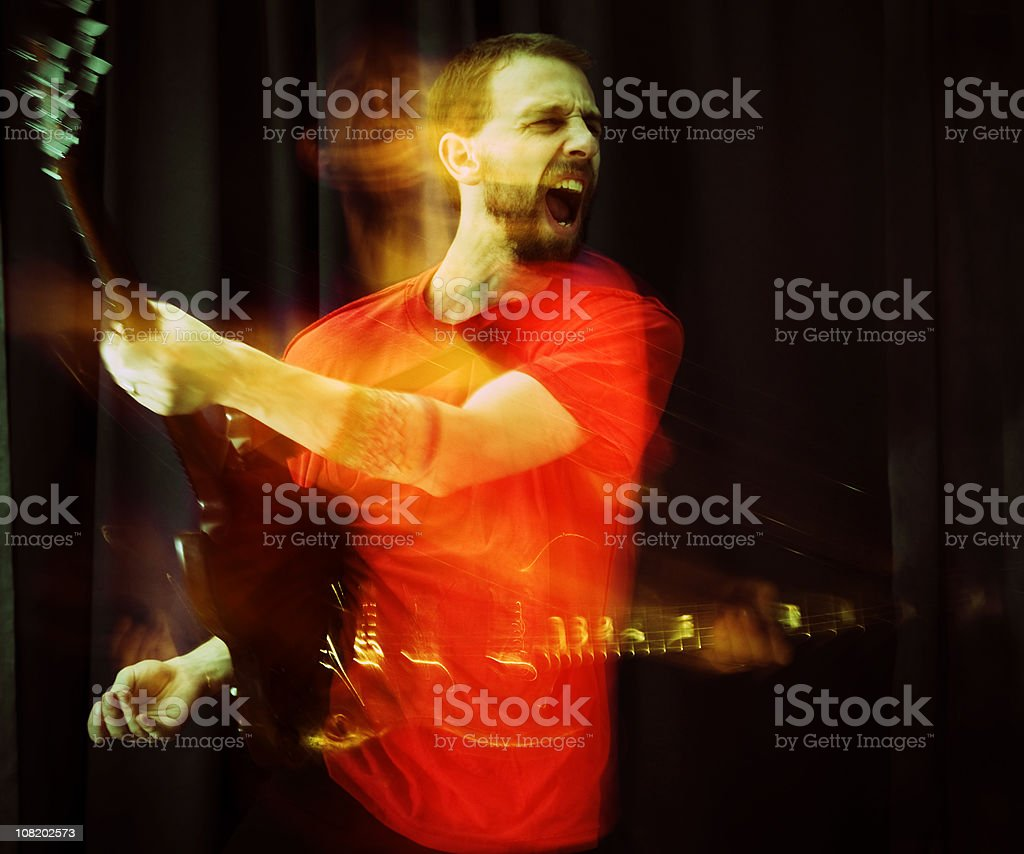 Young Man Playing Guitar, Motion Blur royalty-free stock photo