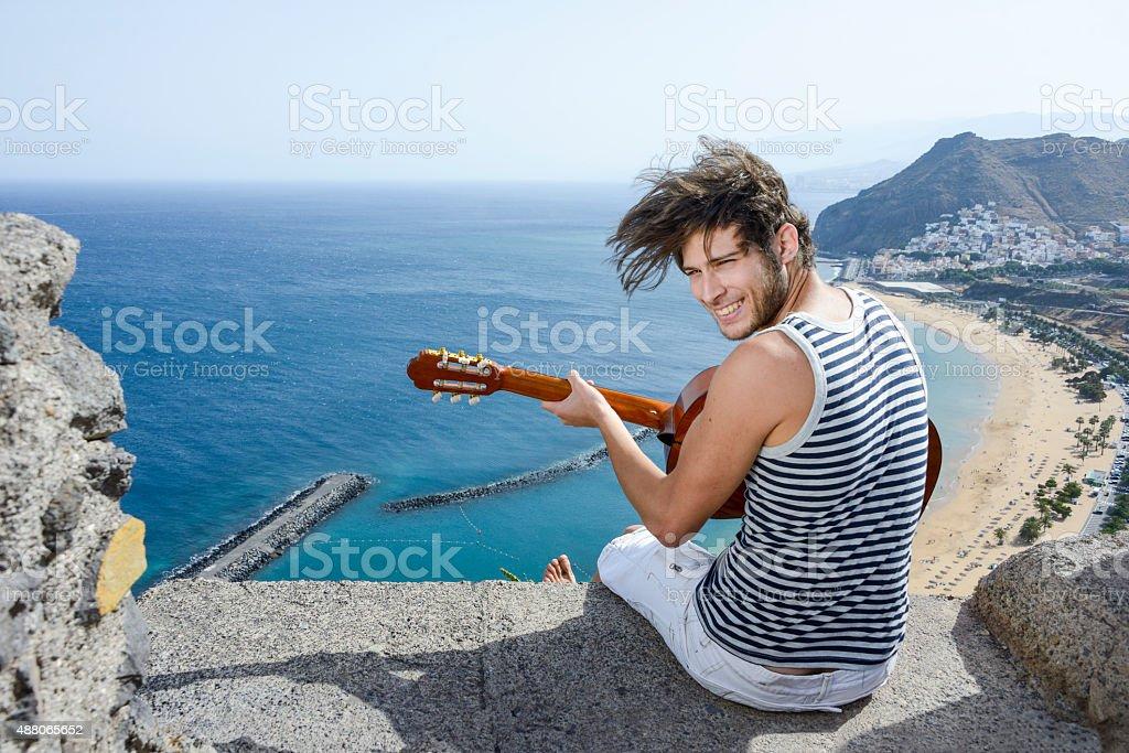 young man playing guitar stock photo