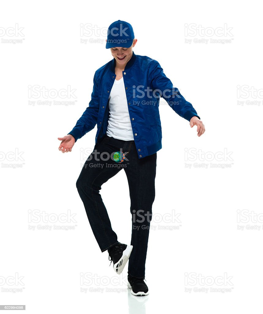 Young man playing hacky sack stock photo