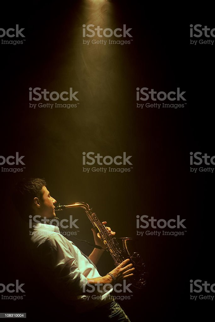 Young man playing saxophone royalty-free stock photo