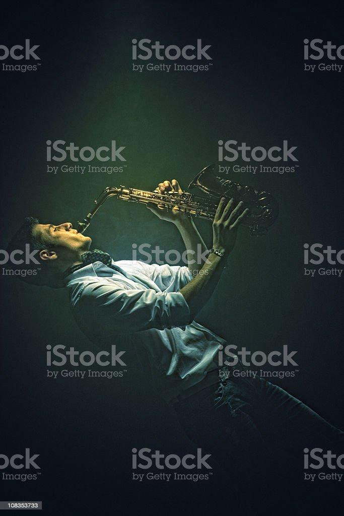 Young man playing saxophone royalty-free stock photo