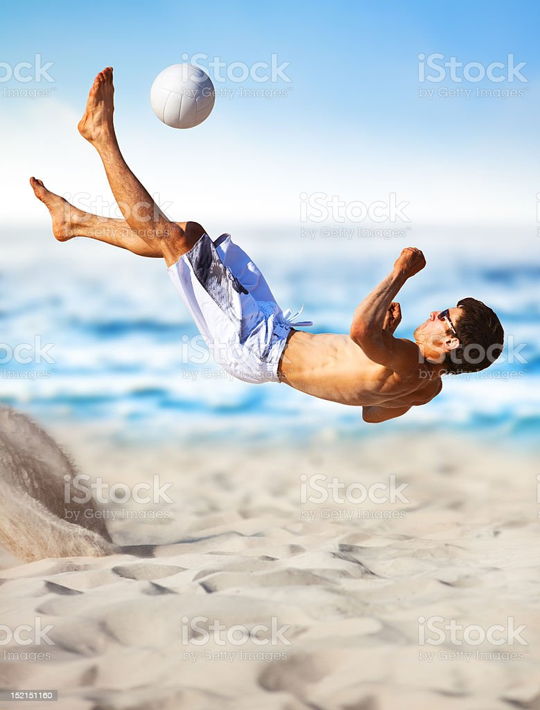 Young man playing soccer royalty-free stock photo
