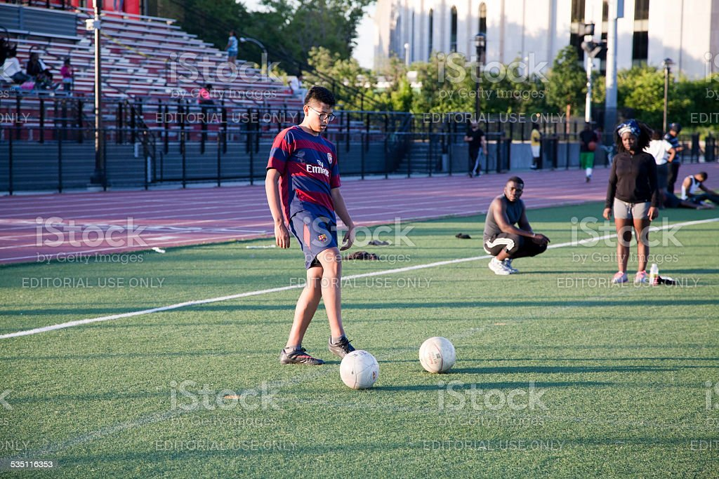 Young man playing soccer stock photo