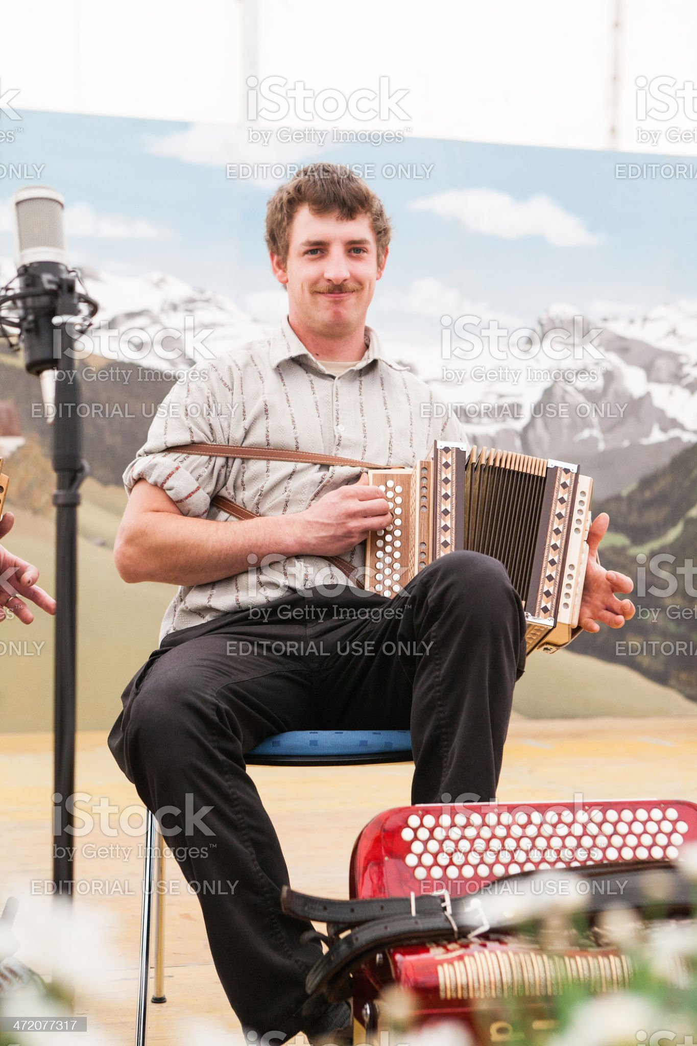 Young man playing Swiss accordion royalty-free stock photo
