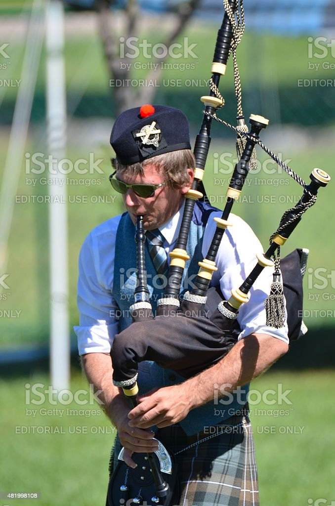 Young Man playing the bagpipes stock photo