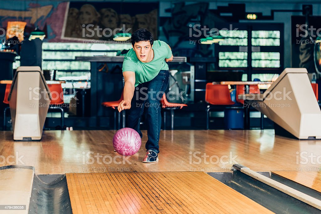 young man plays bowling stock photo